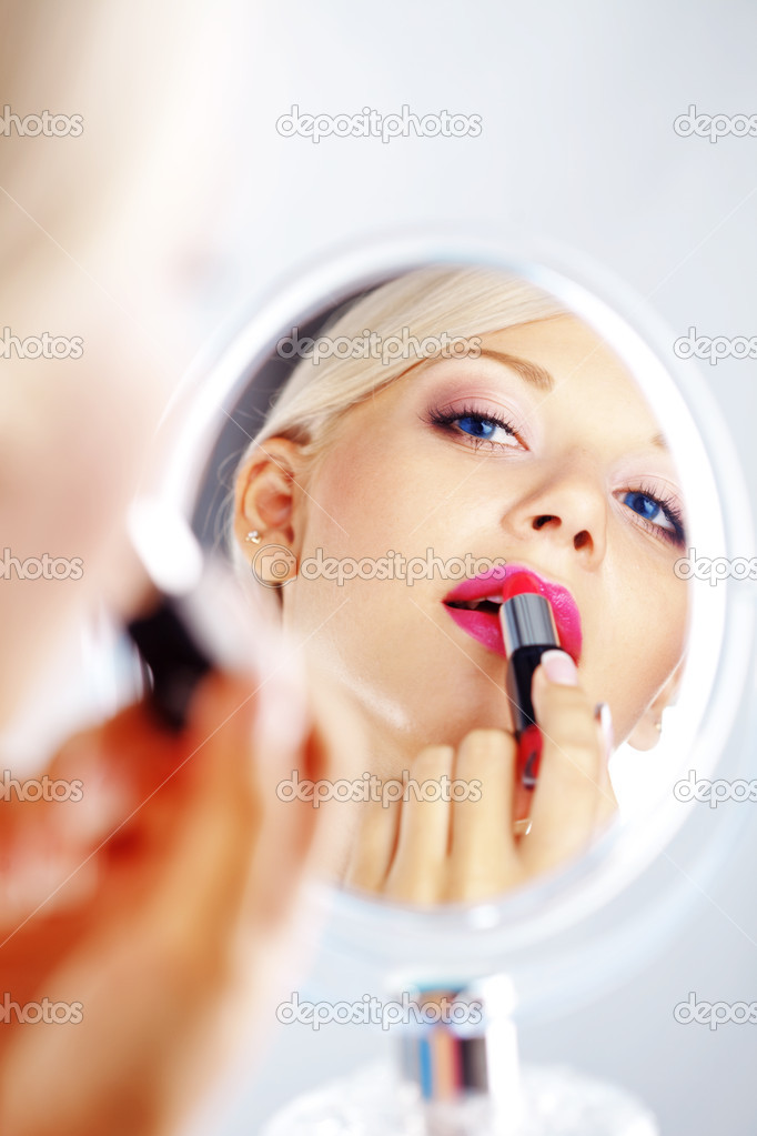 Applying lipstick