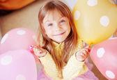 Fotografie Kind mit Ballons