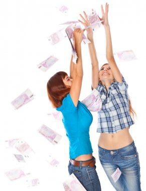 Banknotes of 500 euro are falling on two girls