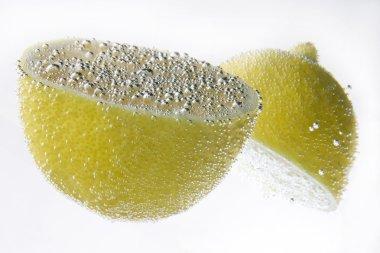 Two lemons in air bulbs under water