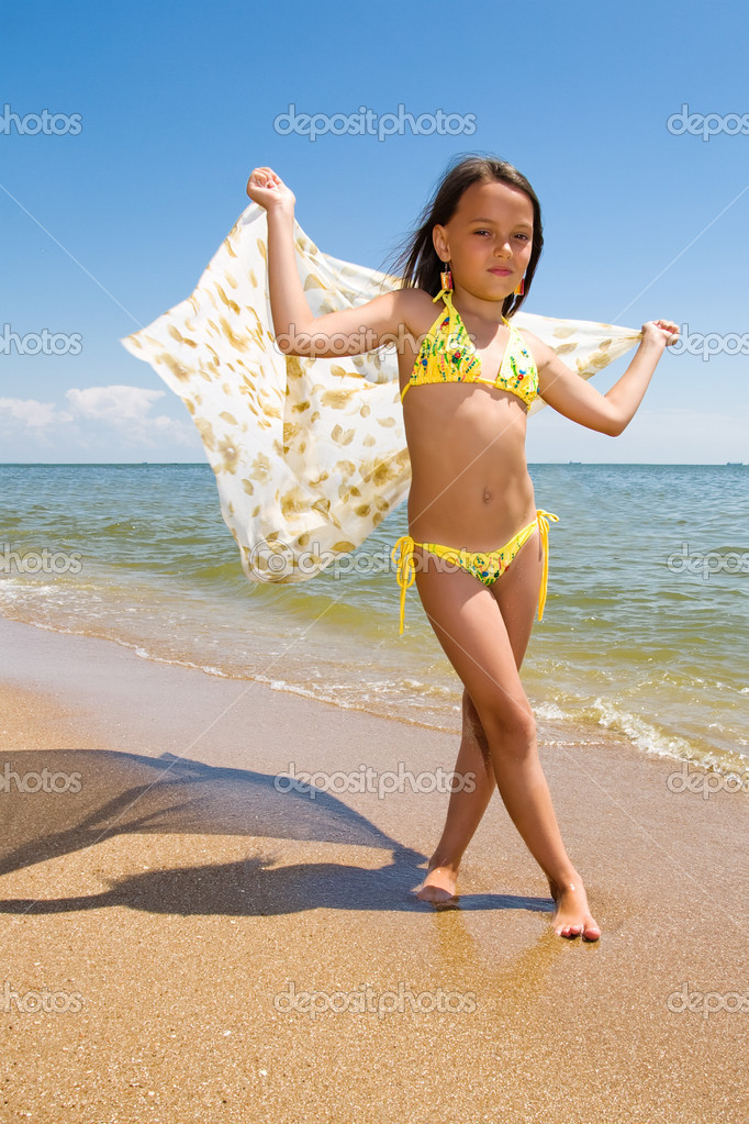 Little girl posing at the seaside