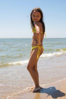 Little girl enjoying her vacation at summer resort