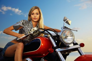Blonde on red chopper