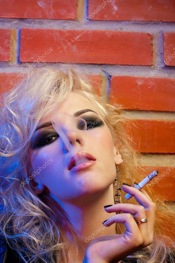 Blonde girl smoking