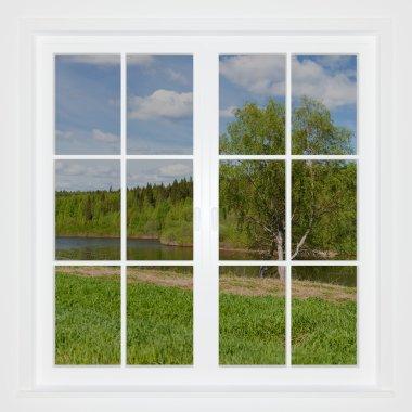 Summer landscape behind a window