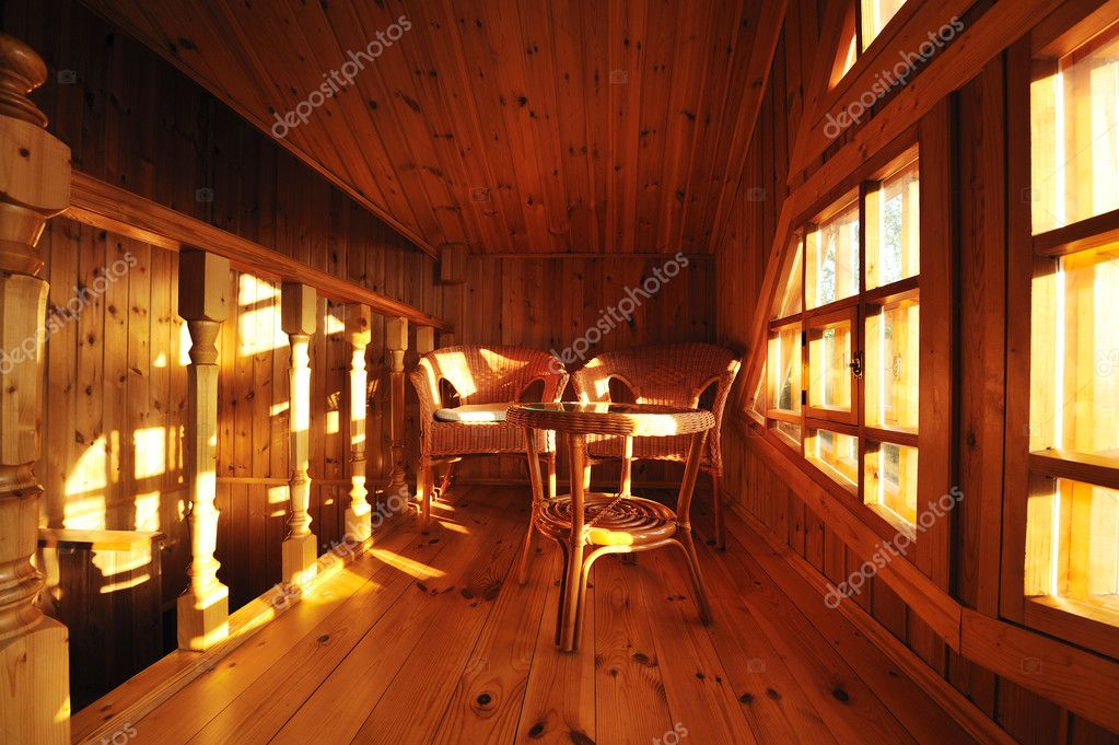 Wooden interior with wicker furniture