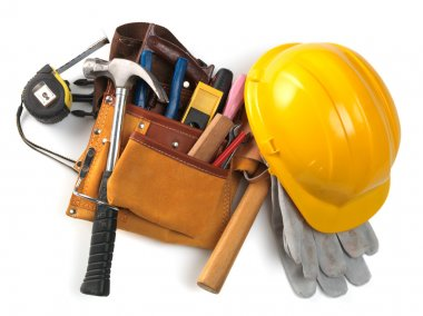 Yellow helmet and different tools isolated