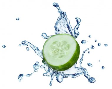 Cucumber in spray of water.