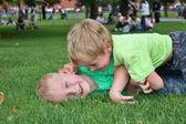 Fotografie Children play in grass