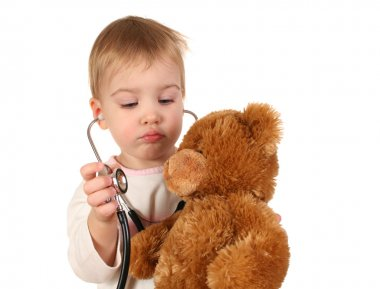 Baby with stethoscope and toy
