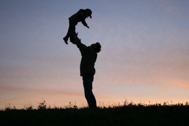 Silhouette father with child