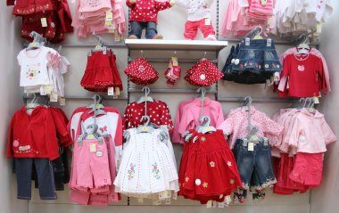 Babies clothes in shop stock vector