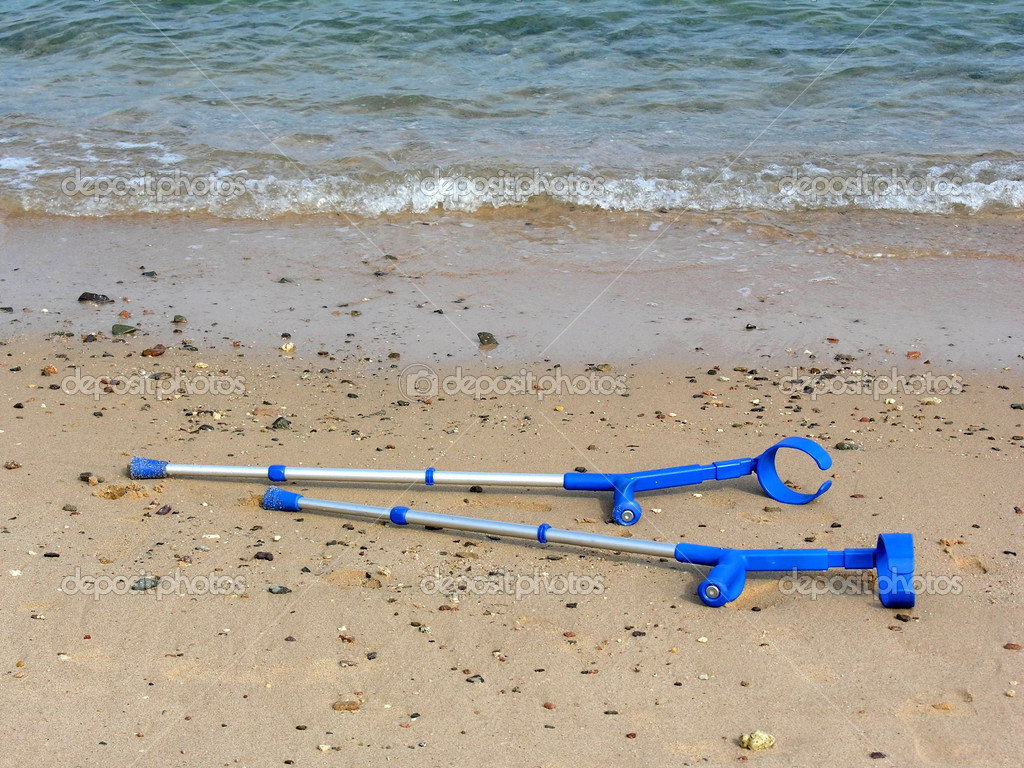 Crutches on beach