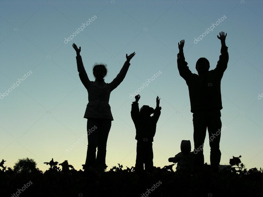 Family hands up sundown