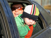 Fotografie Mother with baby in car
