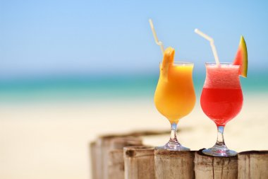 Two tropical fresh juices on tropical beach stock vector