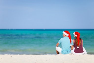 Young couple on Christmas beach vacation