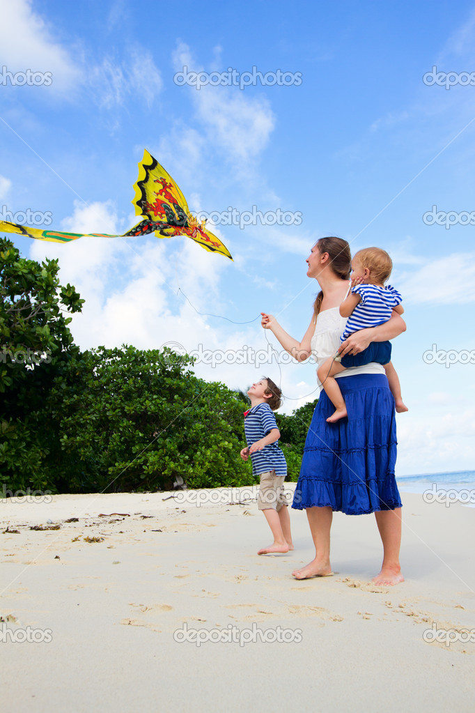 Mother and her two kids flying kite