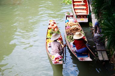 Two vendor on floating market in Thailand