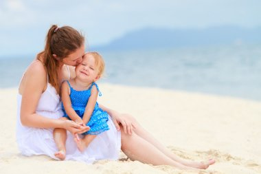 Loving mother and daughter on tropical beach