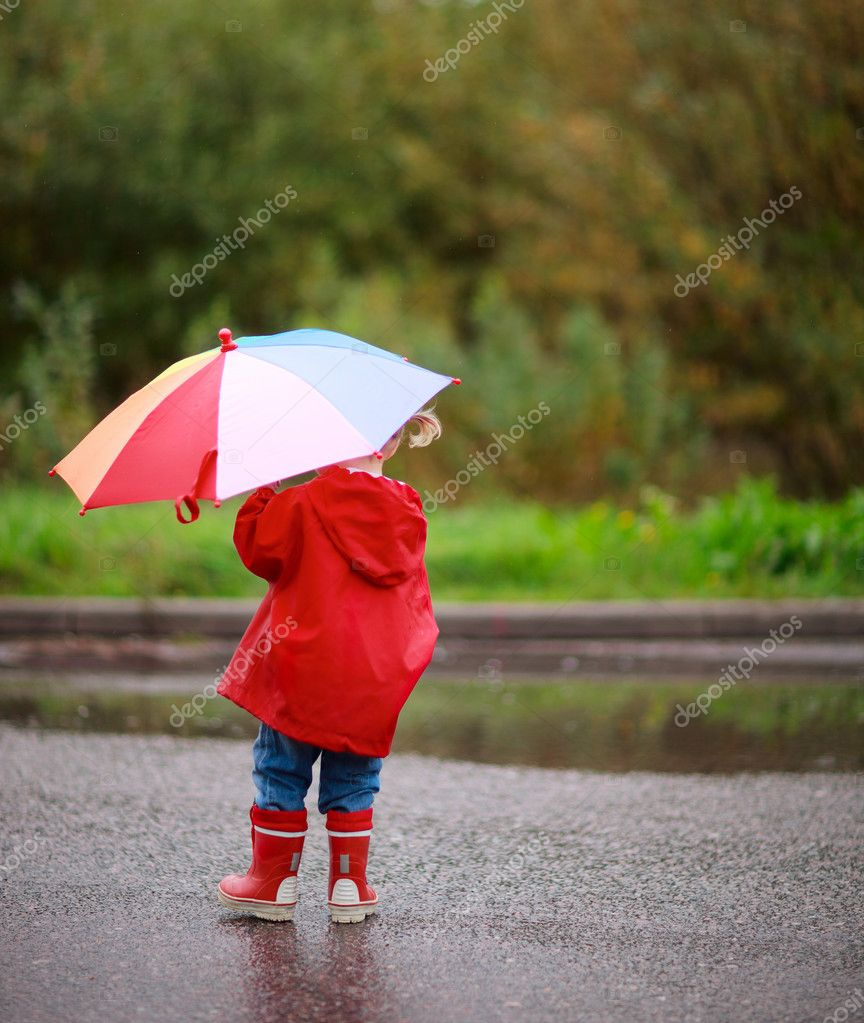 Toddler girl outdoors at rainy day