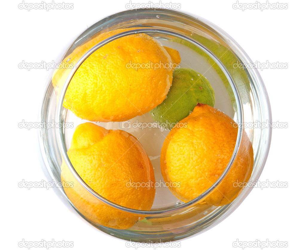 Three lemons and lime in water