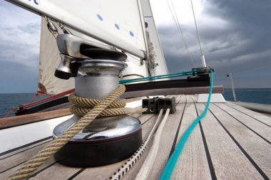 Winch with rope on sailing boat