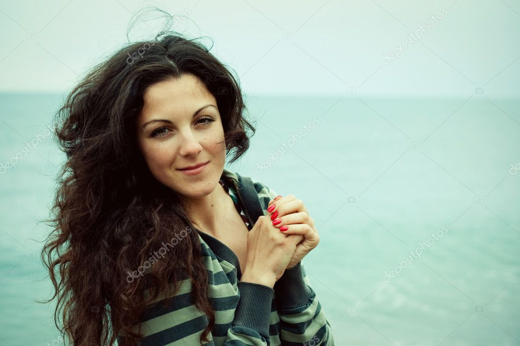 Portrait of beautiful woman on the sea