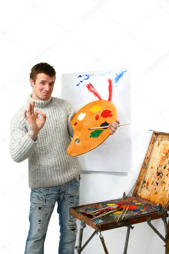 The young artist draws a picture
