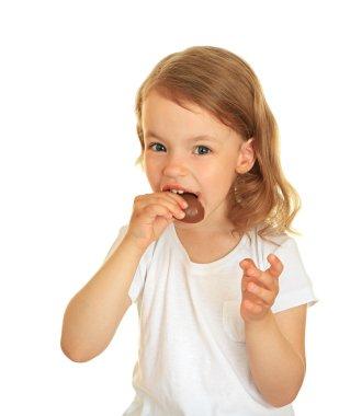 Little girl eating chocolate.