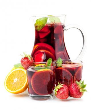 Refreshing fruit sangria in jug and two