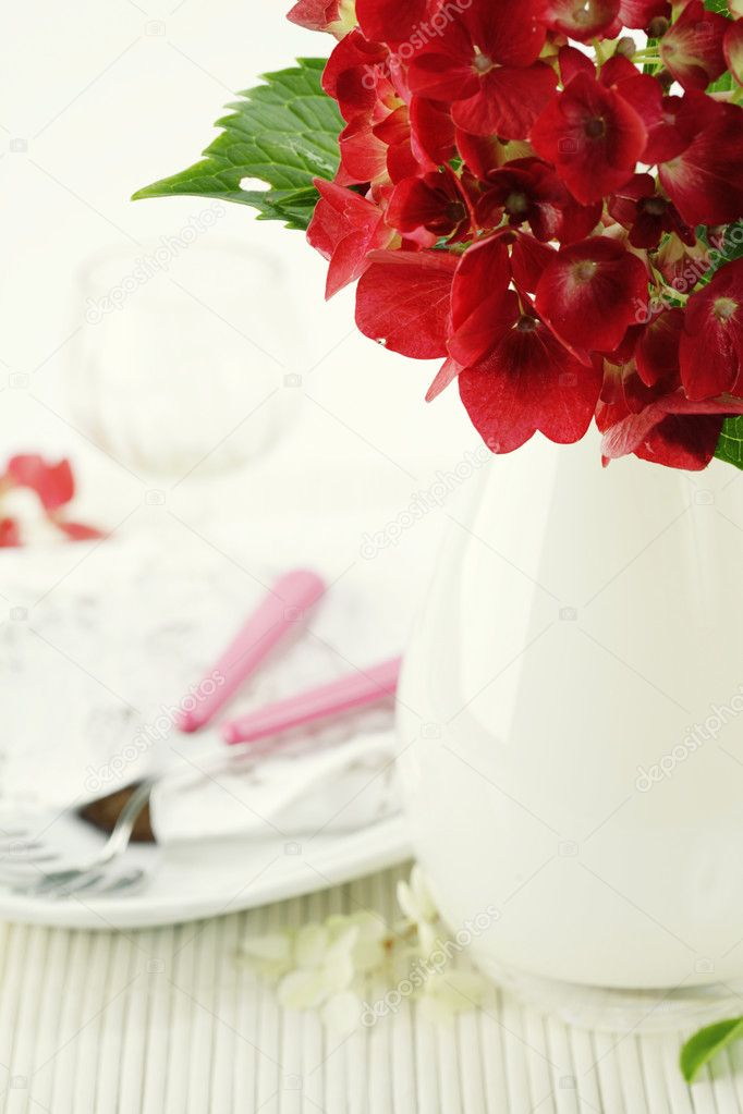 Place setting with hydrangea flower