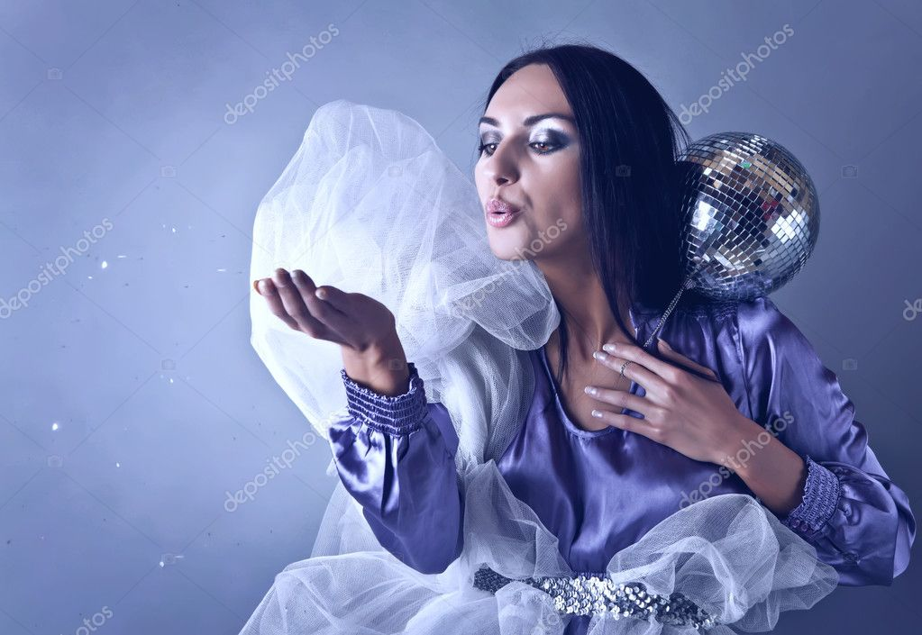 Beautifull woman stylised club fairy blowing off from palm silve