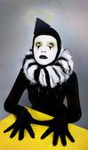 ? ircus móda mime pózuje v blízkosti žlutý square