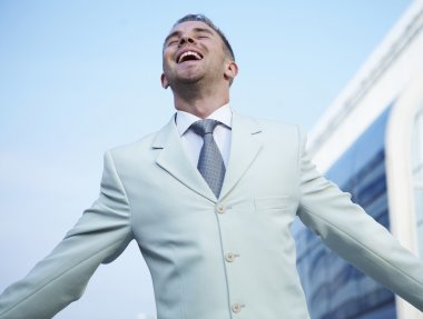 Freedom - Business man - arms outstretched