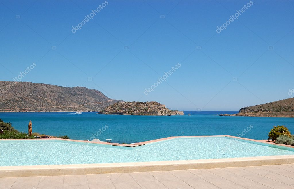 Swimming pool by luxury villa with a view on Spinalonga Island,