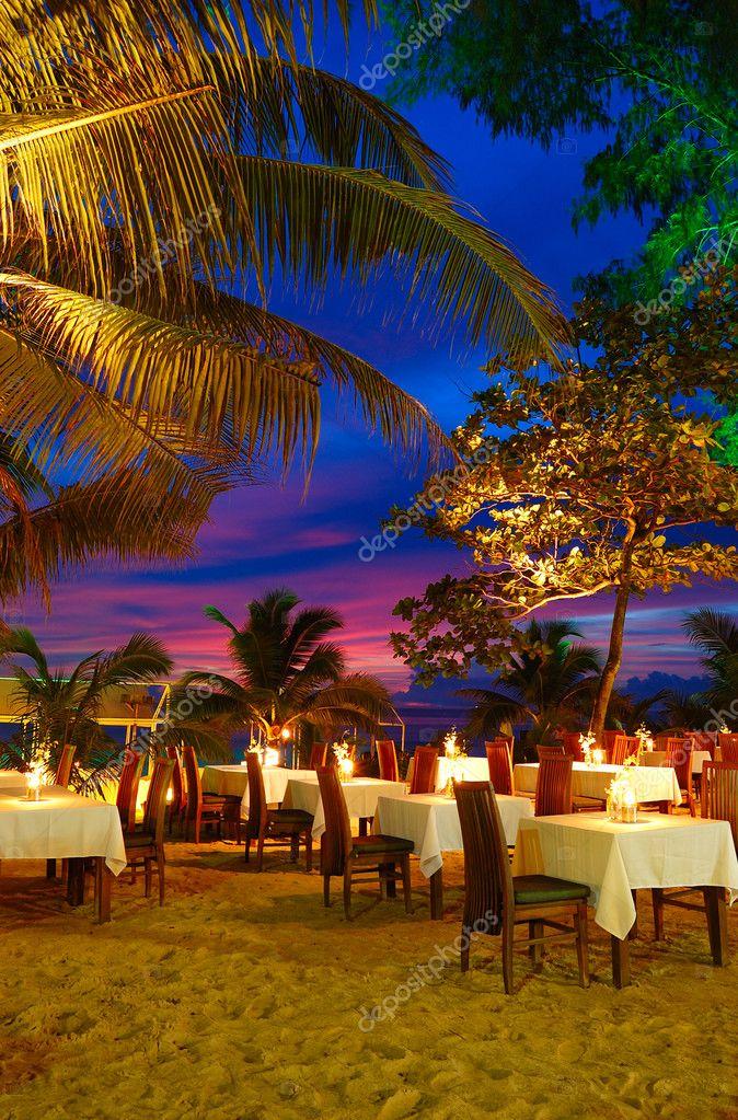 Outdoor restaurant at the beach during sunset, Phuket, Thailand