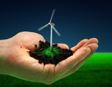 A Human hand holding a wind turbine, dirt and grass. stock vector