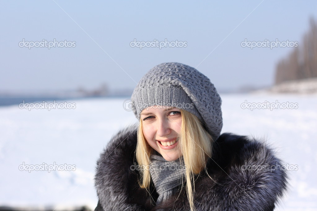 Girl with blonde hair outdoors