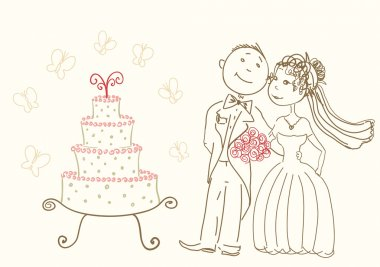 Wedding cake and happy bride and groom