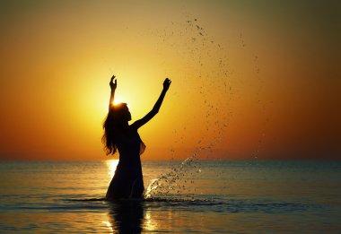 Splashing water in the rays of dawn