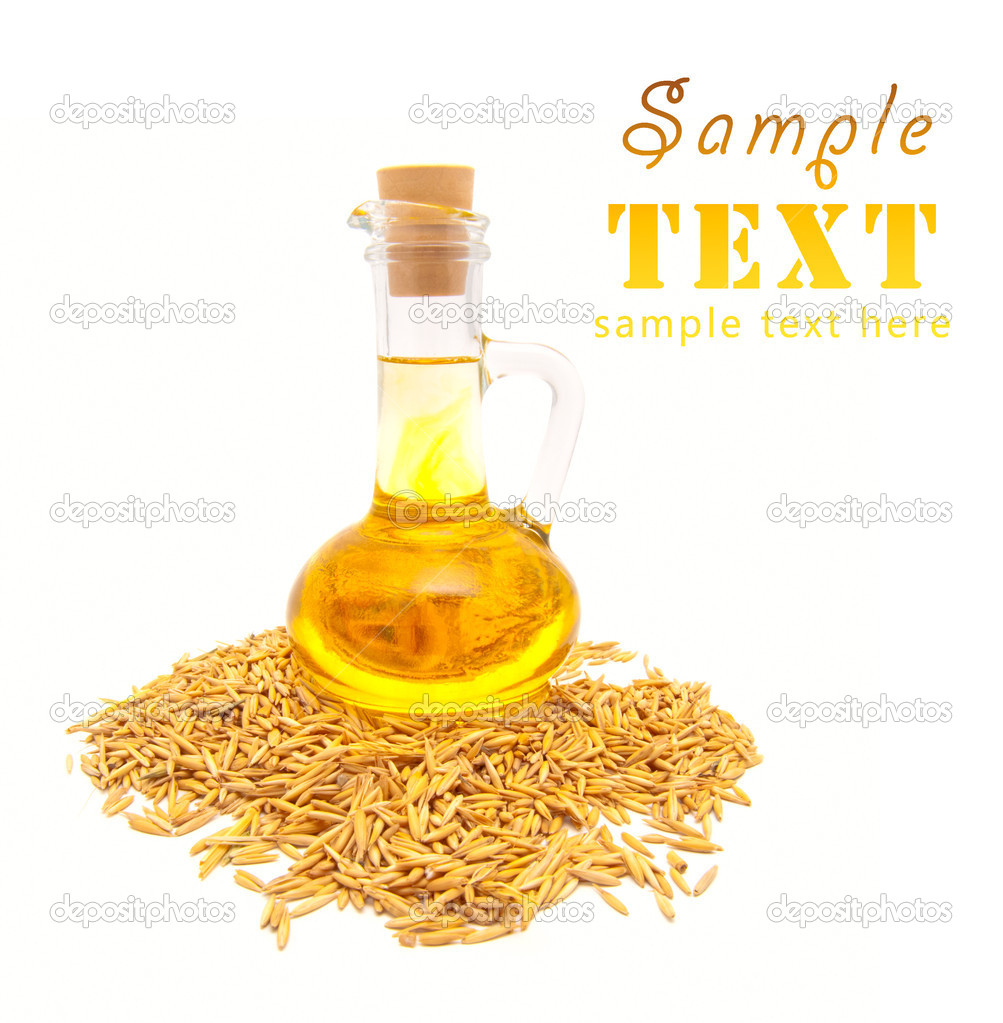 Small bottle with vegetable oil and wheat grains