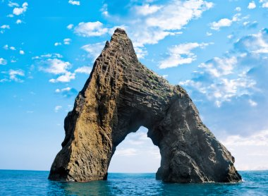 Rock in the form of an arch in the sea - the Crimea