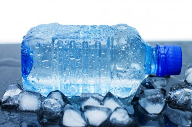Cold water bottle with ice cubes