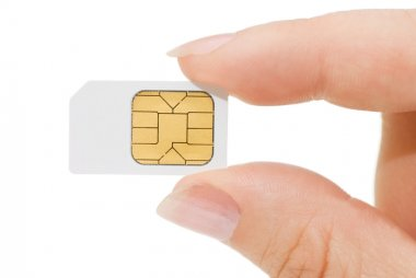 Sim card In a hand isolated on white background