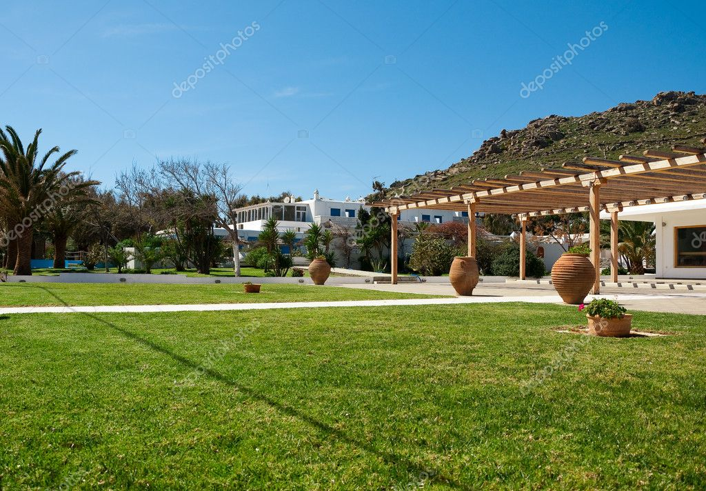 Green lawn in the courtyard of hotel
