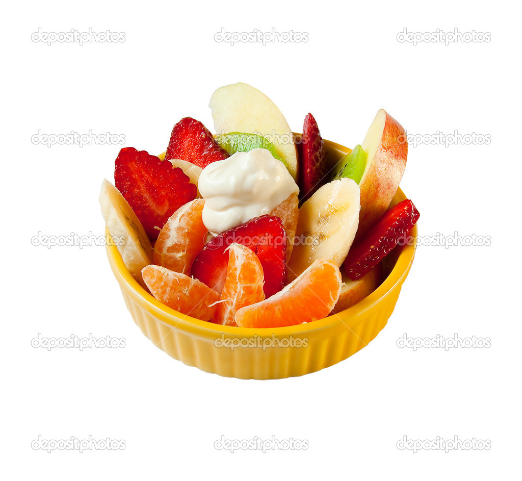 Fruit salad with yogurt in yellow plate