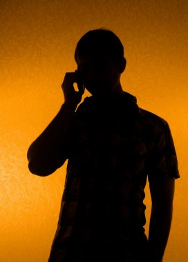 Silhouette of man speak over the phone