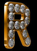 Fotografie Golden R letter incrusted with diamonds