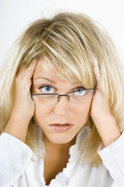 Disheveled girl in glasses